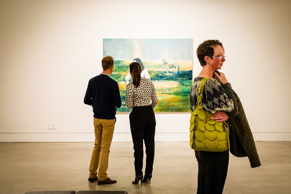 Visitors to the opening: White Noise (2010) in the background. McArthur Family Trust Collection. Photographer: Mark Tantrum