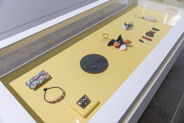 LANGUAGE OF THINGS INSTALLATION VIEW WITH LOLLIPOP NECKLACE & KETE BY WARWICK FREEMAN; BOXED SET: BROOCHES, EARRINGS OR NECKLACE BY ELENA GEE AND I AM BOUND WITHIN THIS LAND AOTEAROA BY JOHN EDGAR
