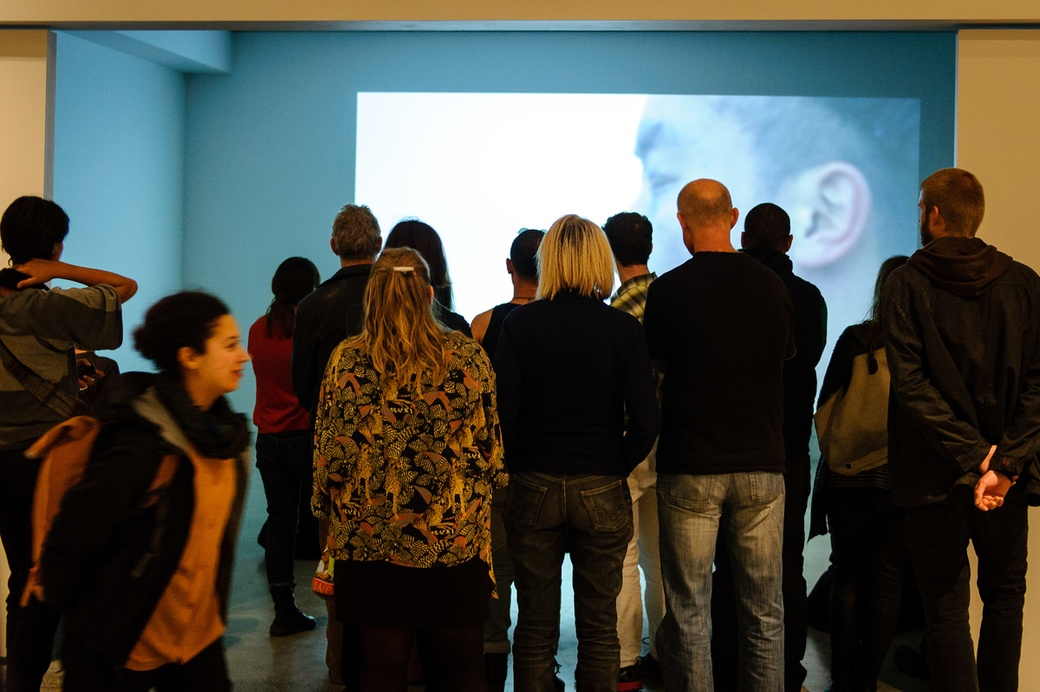 Visitors at the opening of Solo, with Samin Son's 'Home calling, home coming 070007072014', 2014. Photograph by Mark Tantrum
