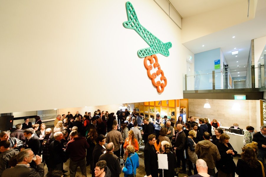 Barry Lett's Green Plane/Red Cloud overlooks the crowd at the opening of New Olds.